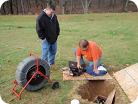 A septic drain field inspection using a sewer video camera.