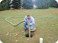 A septic tank is pumped and inspected for problems.