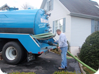 A Bailey's pumping truck arrives to pump out a septic system.